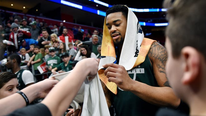 Michigan State's Nick Ward signs autographs for fans at the end of an open practice on Thursday at the Little Caesars Arena in Detroit.