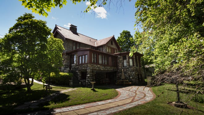 A view toward the back of the century-old four story stone home of Mike Grahek and his late wife Jean.  The 6,400 square-foot home was built in 1918,  It has five bedrooms, four half baths, and two full bathrooms.