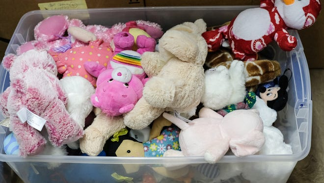 A bin holds soft toys to be added to baby boxes headed for Haiti Tuesday, Sept. 4, 2018.