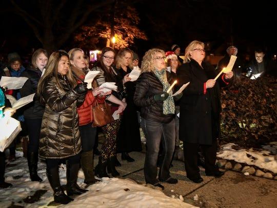 Sandra Kowalk-Thompson, right, leads a surprise Christmas