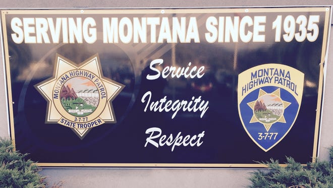 This sign is in front of the Montana Highway Patro headquarters sign in Helena. Note the 3-7-77 on the right. It was added to the shoulder patch in 1956 as a tribute to the vigilantes of the Montana Territory.