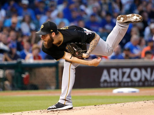 Pittsburgh Pirates starting pitcher Trevor Williams follows through on a pitch during the first inning of a baseball game against the Chicago Cubs Monday, Aug. 28, 2017, in Chicago. (AP Photo/Charles Rex Arbogast)