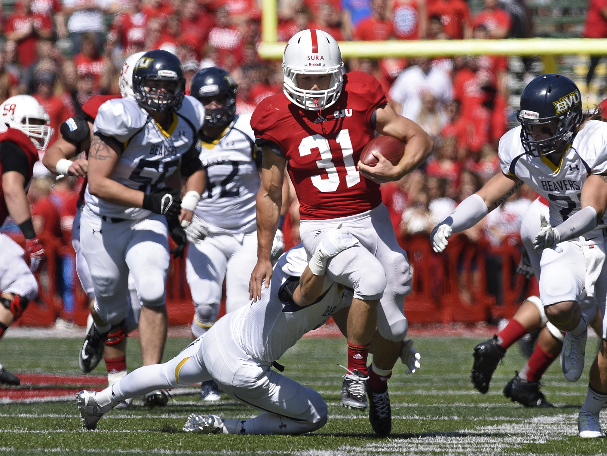 St. John's senior running back Sam Sura carries the ball against Buena Vista earlier this season. The MIAC's leading rusher is one of seven Johnnies' players who graduated from South St. Paul High School. That school faces the Rocori team in high school playoffs this weekend.