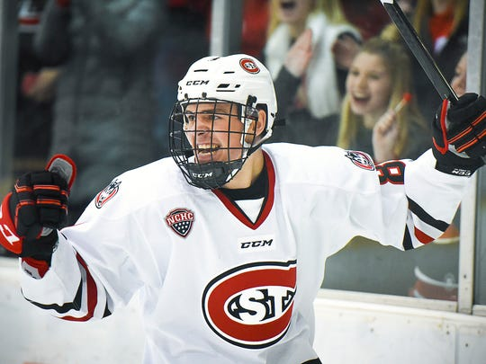 St. Cloud State's Nick Poehling, 8, celebrates his goal against Colorado College during the first half Friday, March 3, at the Herb Books National Hockey Center.