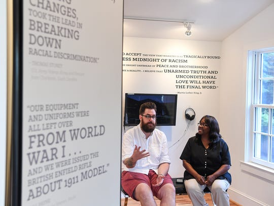 Nick McKinney, left, curator of the Scarborough-Hamer collection in Seneca, talks with Shelby Henderson, right, the Bertha Lee Strickland Cultural Museum manager, in Seneca on Wednesday.