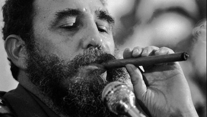 Cuban President Fidel Castro enjoys a cigar in 1978 before he gave up smoking stogies.