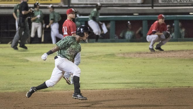 Visalia's Fernery Ozuna celebrates a home run in the ninth inning to tie the score 4-4 with High Desert in Game 1 of the California League Championship Series on Thursday.