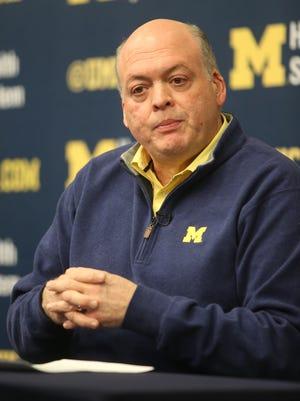 Interim Michigan athletic director Jim Hackett talks with reporters on Saturday, Nov. 22, 2014, in Ann Arbor.