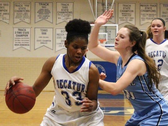 Stephen Decatur's Amaya Mumford posts up on Chesapeake High School's Mikaela Gray during play Thursday night at Stephen Decatur High School in Berlin.