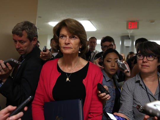 Sen. Lisa Murkowski, R-Alaska, walks to the U.S. Capitol