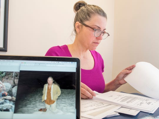Amy Belanger looks through papers relating to her mother Betty Sanders Strong in Pensacola on  December 12, 2017.  Belanger is suspicious about the circumstances behind the 2016 death of her mother.