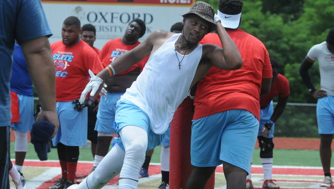 Oxford senior Korbin Harmon (in white) participates in a drill for defensive lineman during a camp. He plans to become a preferred walk-on at Ole Miss, the same school his father, Mike, played for as a flanker.
