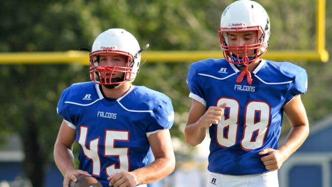 West Henderson's Devin Stepp (45) and Jacob Blackwell are home for Friday's game against Mountain Heritage.