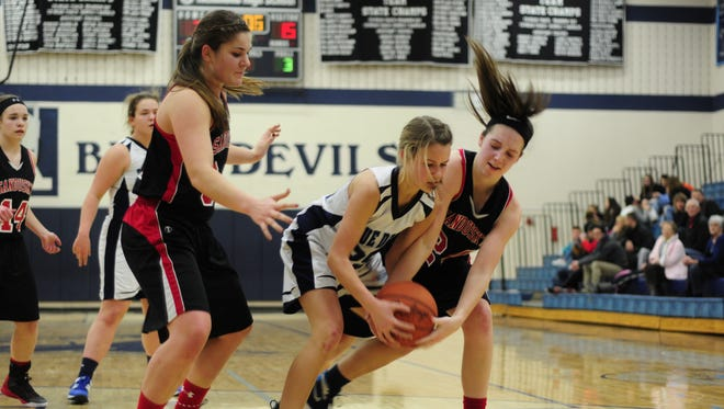Richmond's Jenna Schroeder and Sandusky's Haley Nelson fight for the ball at Richmond High School on Jan. 3, 2017.