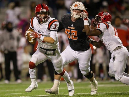 San Augustine's quarterback Gavin Murr looks for an