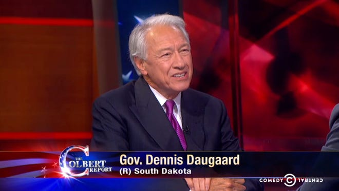 An actor impersonating Gov. Dennis Daugaard appears on the Colbert Report on Monday, Oct. 13, 2014.