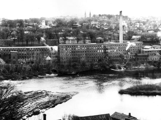 Historic photo of Winooski mills and nearby neighborhood.