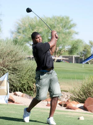Calais Campbell of the Arizona Cardinals hits a shot during the 2011  Jared Allen Night-OPS charity golf tournament at Ancala Country Club in Scottsdale.