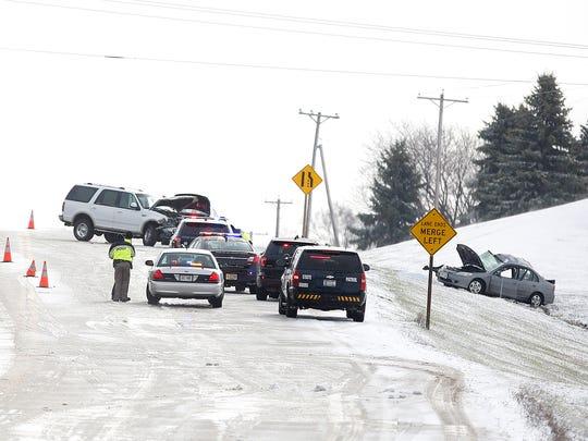 Emergency crews investigate a vehicle crash on Highway