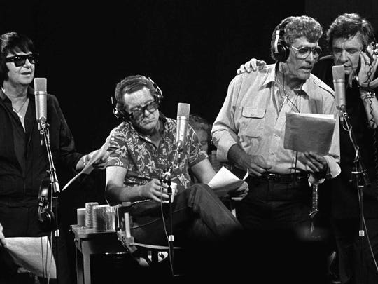 "From left, Roy Orbison, Jerry Lee Lewis, Carl Perkins, Johnny Cash and producer Chips Moman sing during the recording of the ""Class Of 55"", a reunion album that Moman recorded using four legnedary rock 'n rollers that got their starts in Memphis.  The face between Cash and Moman is lead guitar player Reggie Young.  This scene took place at Moman's old American Recording Studio on North Thomas."