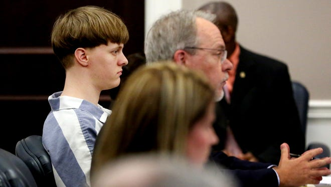 Dylann Roof (left) enters his guilty plea on murder charges in the court room at the Charleston County Judicial Center Monday, April 10, 2017, in Charleston, S.C.