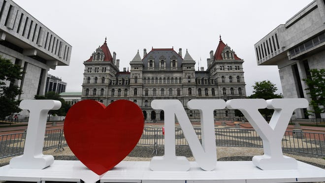 Promotional I Love NY sign waiting for installation in front of the New York state Capitol on the Empire State Plaza Tuesday, June 18, 2019, in Albany, N.Y.