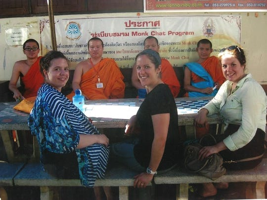 """Benke and other women in the program participate in """"monk chat,"""" speaking with Buddhist monks while in Thailand. Buddhism is the major religion in Thailand."""