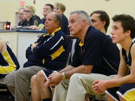 Algonac boys basketball coaches John Highstreet, right,