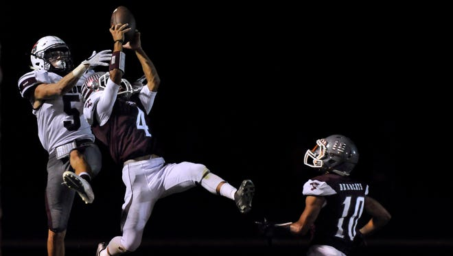 Hawley defensive back Johnny Donnelly intercepts a pass meant for Seymour's Garrett Siegert during Friday's game, a 28-0 loss for the Panthers.