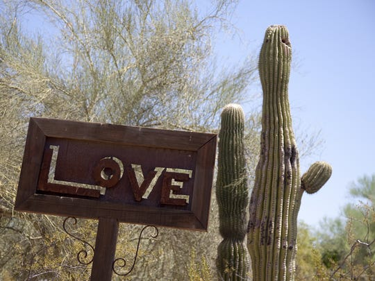 "A ""Love"" sign is shown at Cattle Track in Scottsdale,"