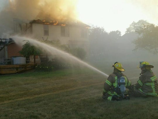 Firefighters work to extinguish the flames
