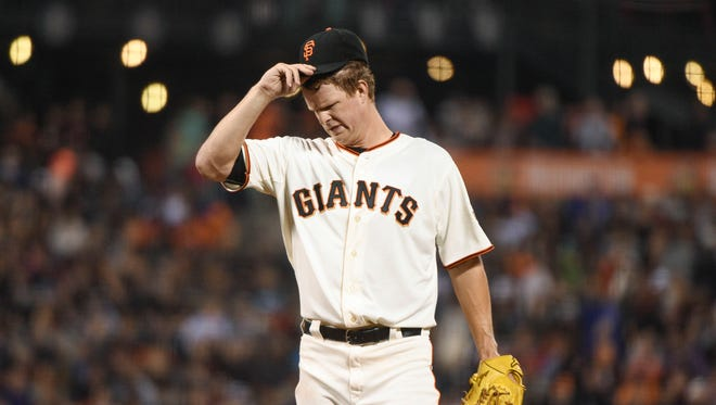 San Francisco Giants starting pitcher Matt Cain (18) reacts during the fourth inning against the Chicago Cubs at AT&T Park.