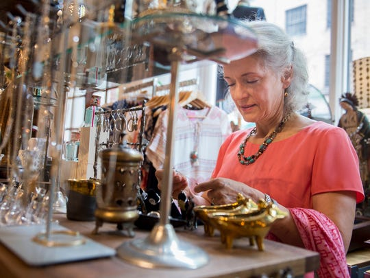Anne Marie Kempf, of Nashville, browses while shopping at Fire Finch, Thursday, June 2, 2016, in Nashville, Tenn.