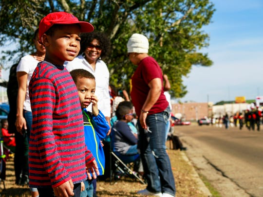 Youngsters watch the MLK Day parade in Laurel.