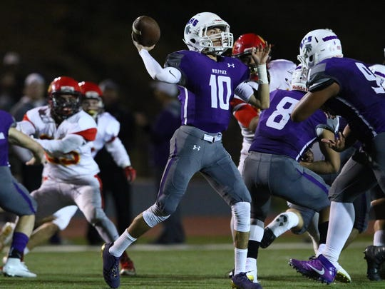 Shasta High quarterback Ian Garcia (10) looks for an open receiver in the second quarter of the Nov. 24 NSCIF Division II section championship game at Thompson Field in Redding.