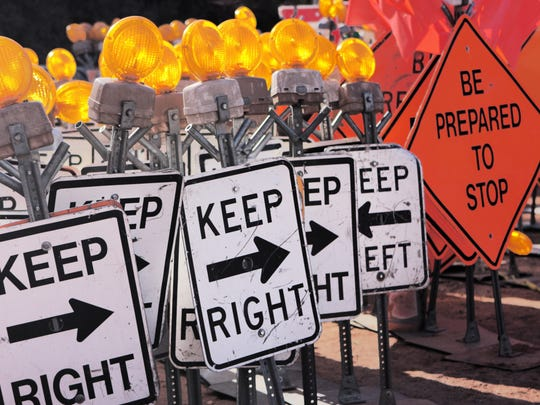 Road construction safety signs including black white