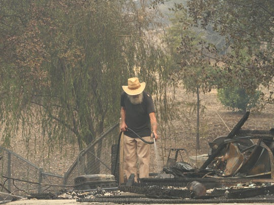 These images show the aftermath of the Carr Fire in Redding. Residents returned to their homes in Mary Lake to begin the clean up after the fire. Houses burned down in Quartz Hill Road, Keswick Dam Road, and neighborhoods along Sacramento River by Keswick Dam.  (Hung T. Vu/Special to the Record Searchlight)