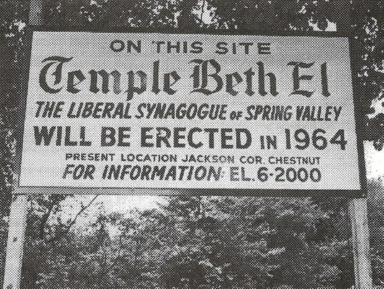 A photo of a sign  in 1964 indicating where Temple