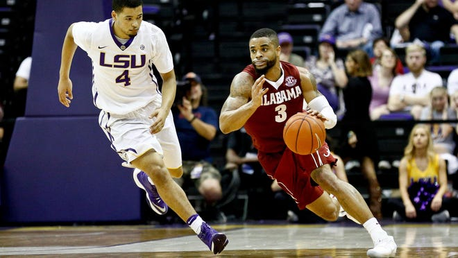 Alabama Crimson Tide guard Corban Collins (3) drives past LSU Tigers guard Skylar Mays (4) during the second half of a game at the Pete Maravich Assembly Center. Alabama defeated LSU 81-66.