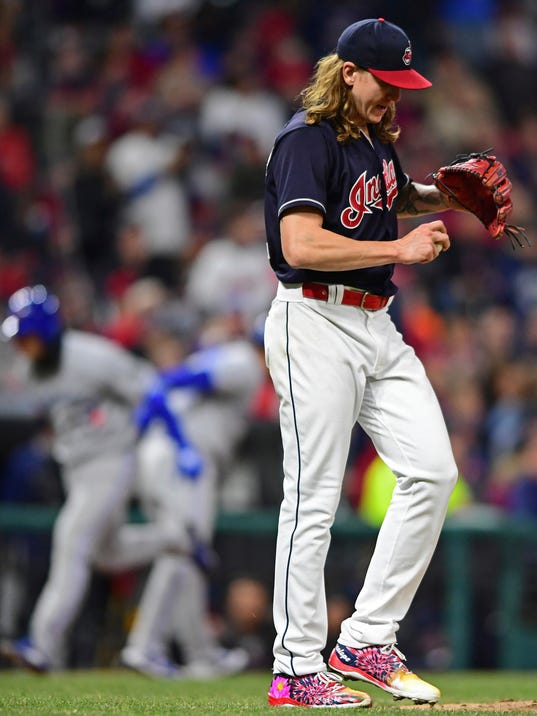 Cleveland Indians starting pitcher Mike Clevinger waits for Toronto Blue Jays' Aledmys Diaz to run the bases after hitting a three-run home run during the fourth inning of a baseball game Friday, April 13, 2018, in Cleveland. (AP Photo/David Dermer)