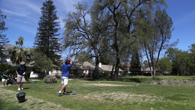John Piro tees off at the sixth hole March 31 at River Tasalmi Golf Club. The nine-hole course's final day of business that day.