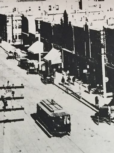 Central Avenue looking east in 1898. One of the Pullman open trolley cars has the street nearly to itself.