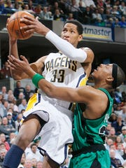 Danny Granger (All-Star in 2008-09) is fouled by Paul