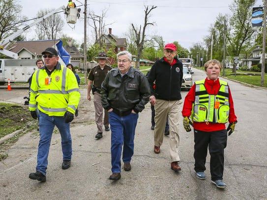 Iowa Gov. Terry Branstad, center, tours the damage