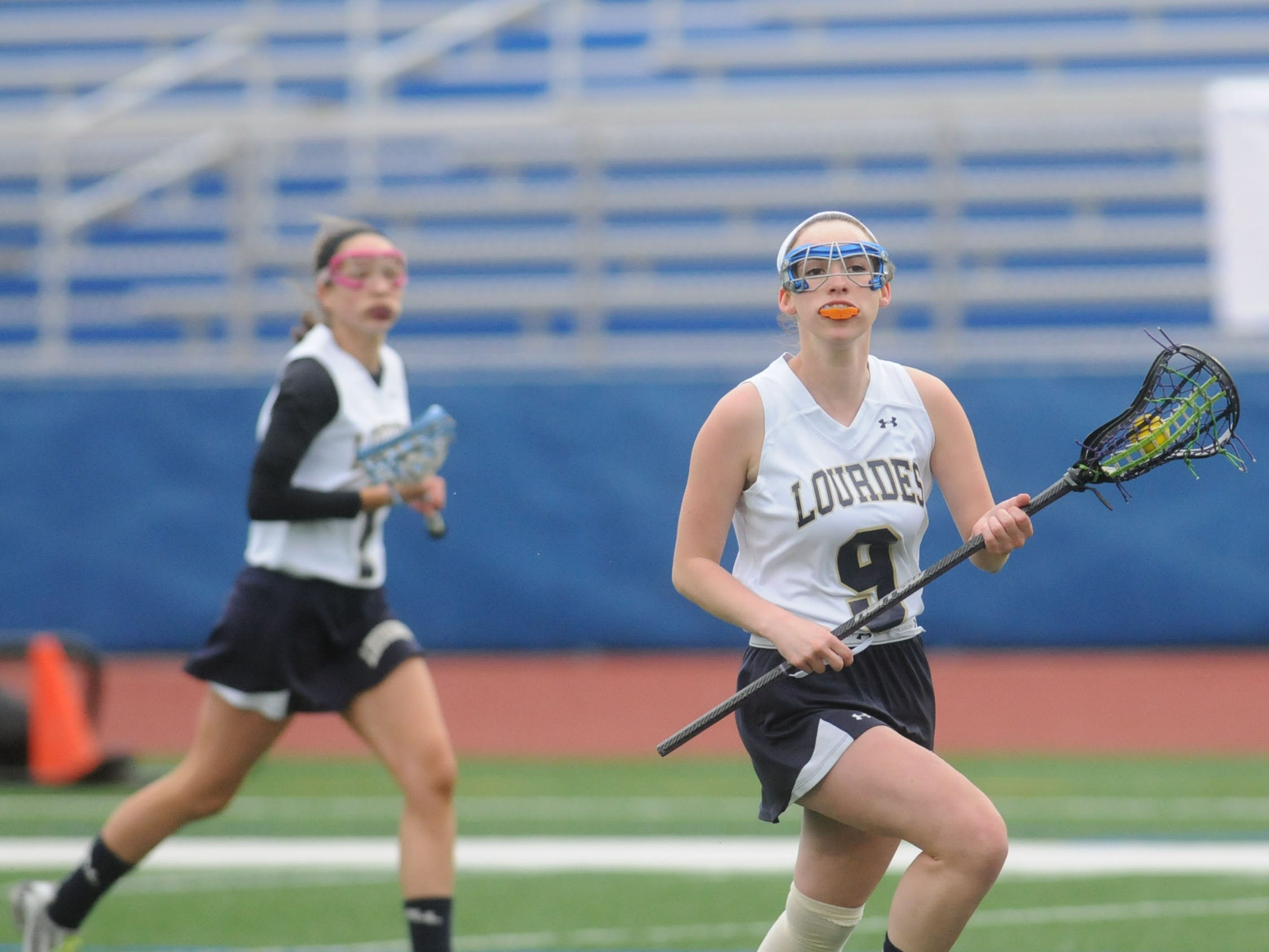 Lourdes' Sophia Stanford takes the ball down field in Monday's game against Valley Central.