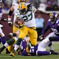Green Bay Packers running back Eddie Lacy (27) breaks away for a big run against the Minnesota Vikings at TCF Bank Stadium in Minneapolis.