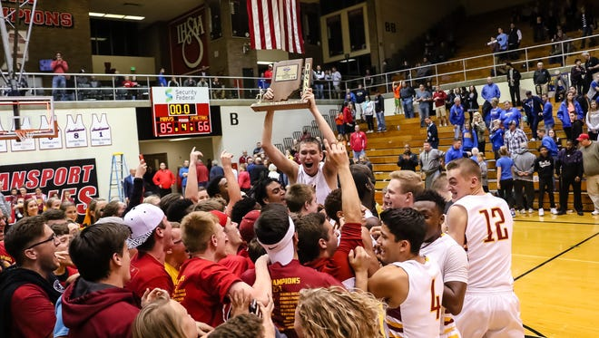 Action as McCutcheon beats Homestead  to win the regional championship. Saturday, March 12, 2016.