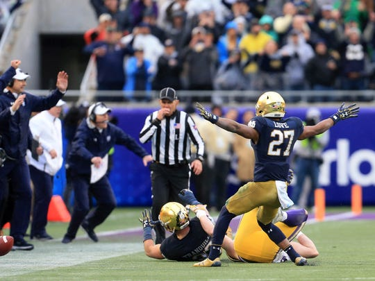 Notre Dame Fighting Irish cornerback Julian Love (27) celebrates after a turnover on downs late in the fourth quarter against the LSU Tigers in the 2018 Citrus Bowl at Camping World Stadium.