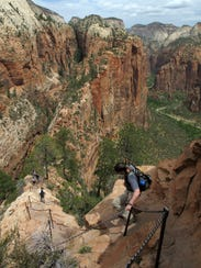 Hikers climb down the Angel's Landing Trail in Zion