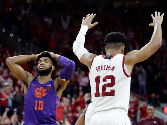 Clemson's Gabe DeVoe (10) reacts after missing a free-throw in the closing moments as North Carolina State's Allerik Freeman (12) celebrates during an NCAA college basketball game in Raleigh, N.C., Thursday, Jan. 11, 2018.